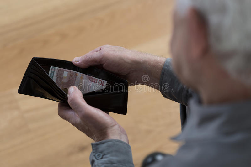 Empty wallet. Old man with empty wallet and financial difficulties royalty free stock photography