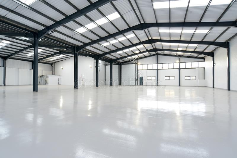 An empty warehouse. Empty warehouse unit with shiny floor stock images
