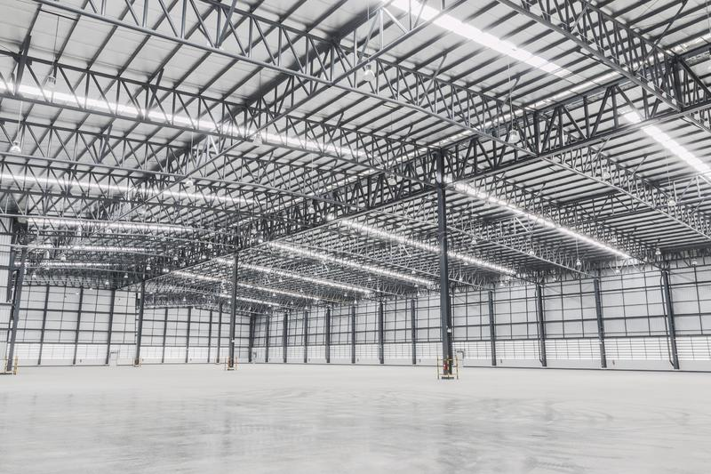 Empty warehouse. Factory building or warehouse building with concrete floor for industry. Industrial concept stock photo