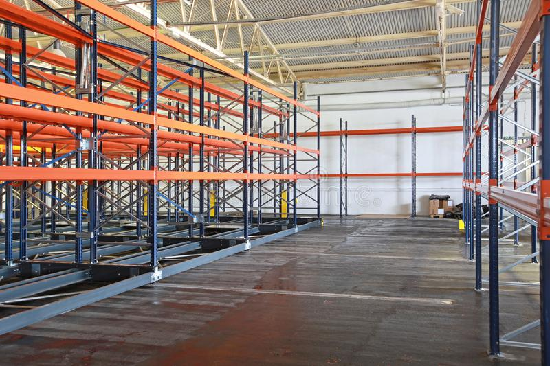 Empty Warehouse. Empty Shelving System in Distribution Warehouse stock images