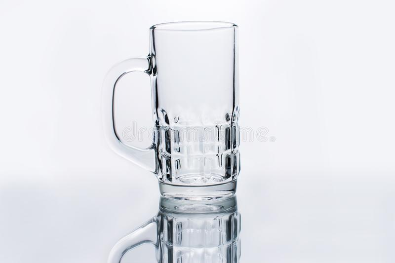 Empty water glass on a white background royalty free stock image