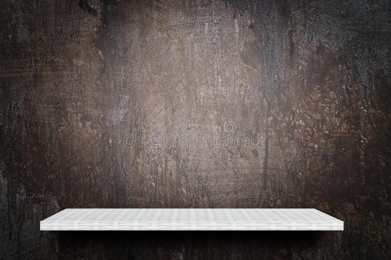 Empty shelf counter on brown grunge background stock images