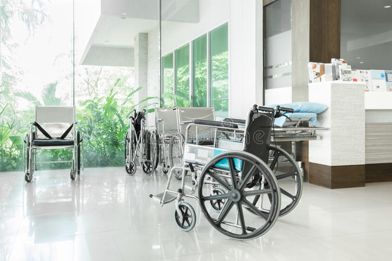 Empty wheelchair parked in hospital hallway royalty free stock image