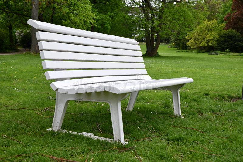 Empty white bench. In a park royalty free stock image