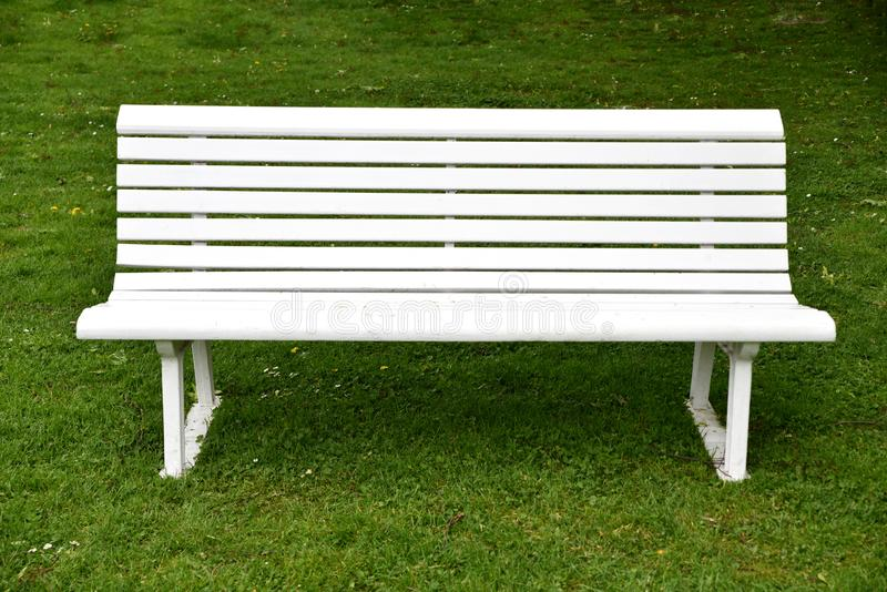 Empty white bench. In a park stock photography