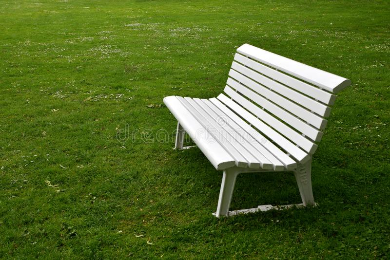 Empty white bench. In a park stock photo