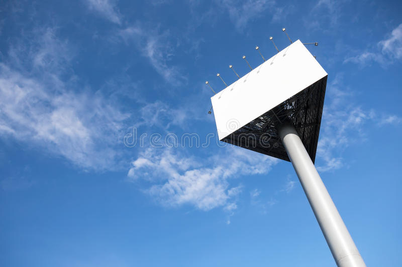 Empty white billboard. Empty white triangle billboard on the sky background royalty free stock photo