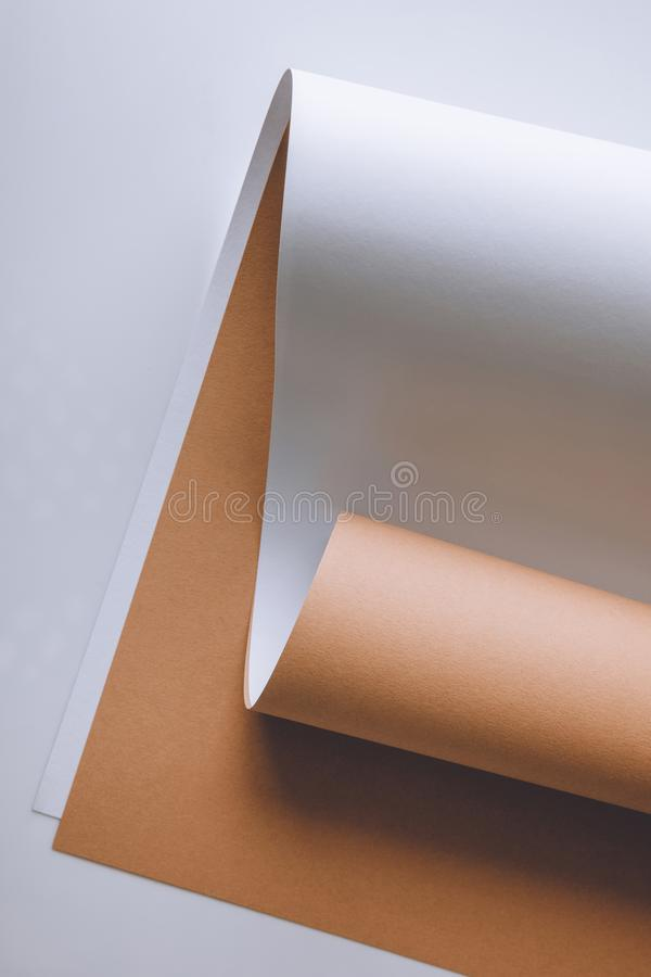Empty white and brown paper sheets on grey background royalty free stock photos
