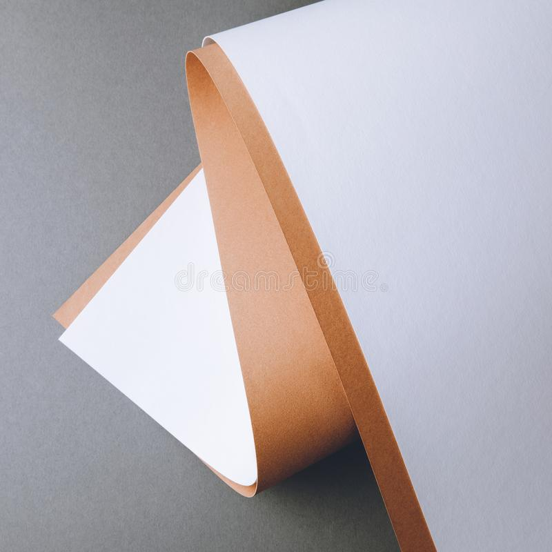 Empty white and brown paper sheets on grey creative background stock image