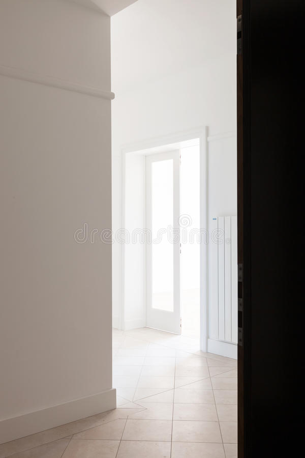 Empty white corner of an old apartment royalty free stock photos