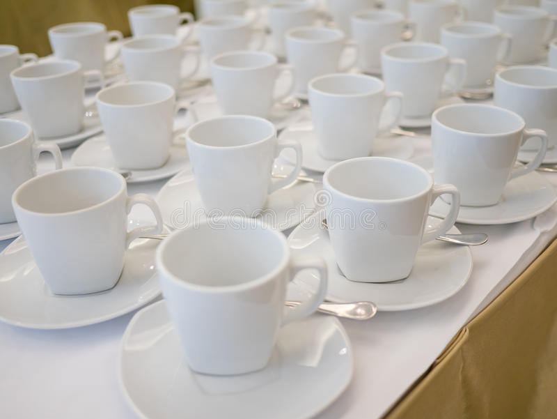 Empty white cup. Prepared for coffee or tea break in hotel while meeting stock photography
