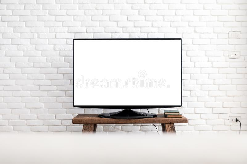 Empty white flat TV screen hanging on a white wall stock photo