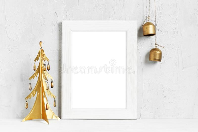 Empty white frame and golden Christmas decoration stock photo