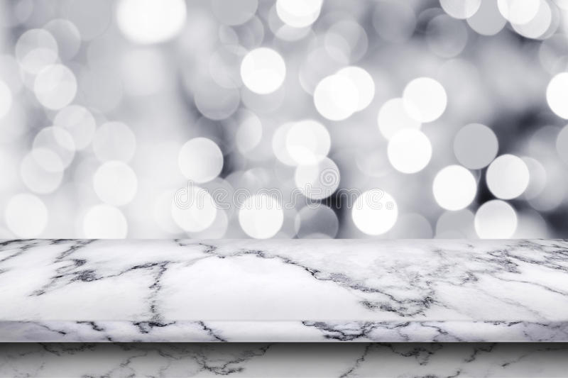 Empty white marble table on abstract bokeh background. royalty free stock images