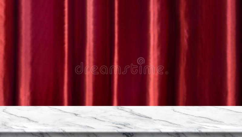 Empty white marble table and blurred vivid red luxury curtain background. product display template.Business presentation royalty free stock images