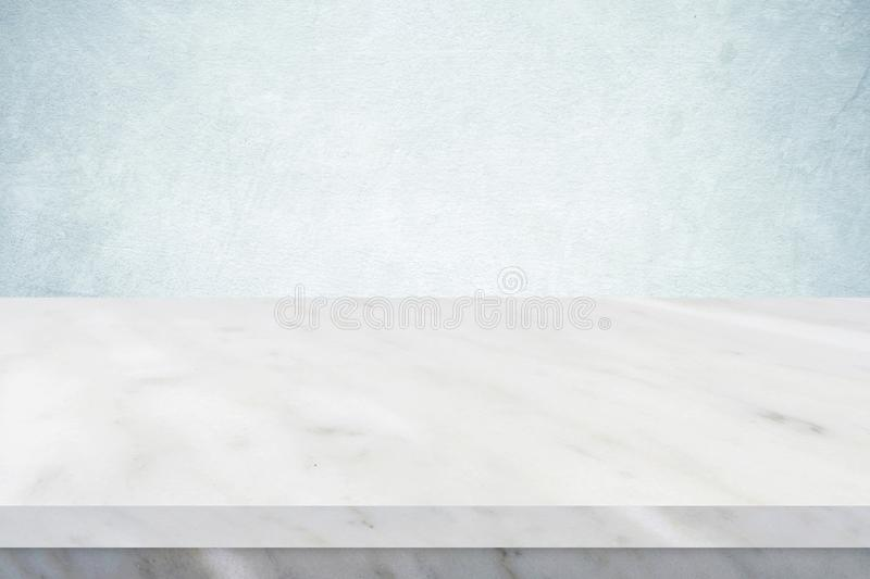 Empty white marble table over green cement wall background, banner, table top, shelf, counter design for product display montage royalty free stock photography