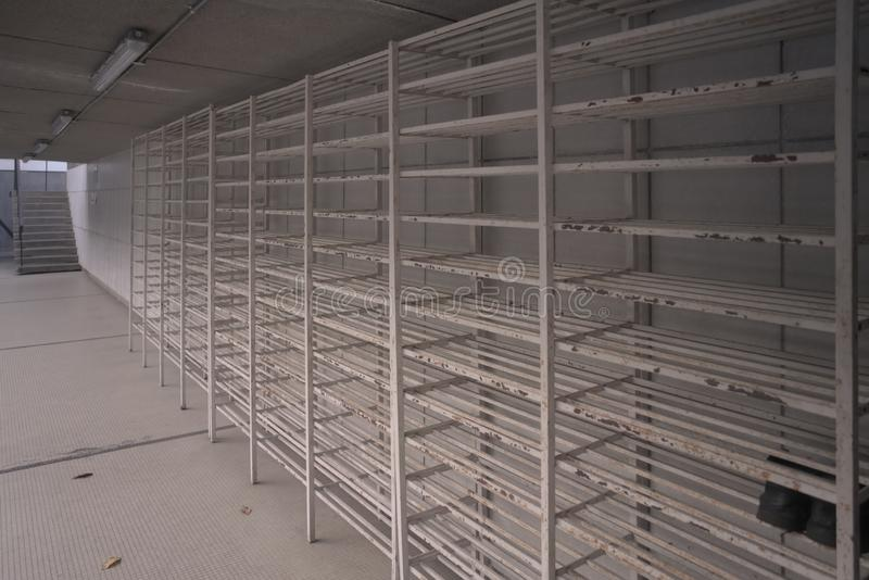 Empty white metal bars shoes rack at the mosque royalty free stock images
