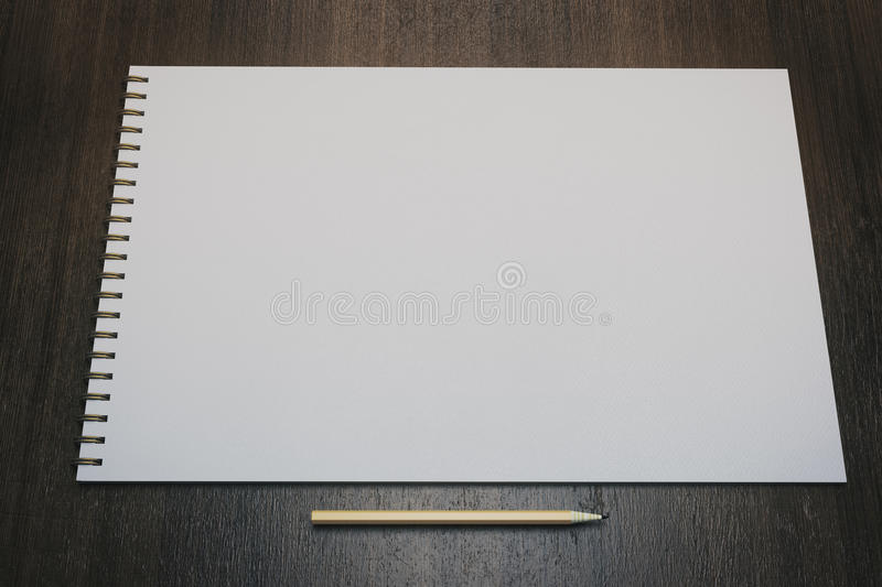 Empty white notepad. Close up of white spiral notepad and pencil on wooden surface. Mock up, 3D Rendering vector illustration
