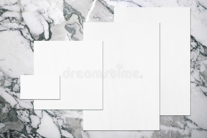 Empty white office stationery mockups on neutral grey marble background royalty free stock images
