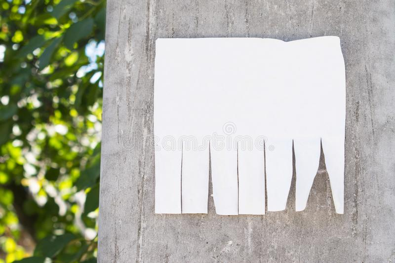 Advertisement Paper With Cut Slips On Wooden Background ...