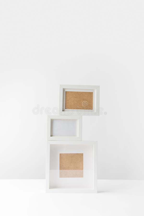 Empty white photo frame. S stacked on white royalty free stock photography