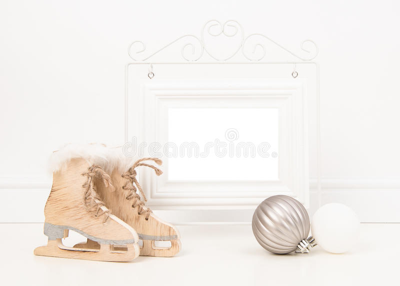 Empty white picture frame with space for text or wishes in a white living room setting with pink baby sock and pink and white rubb royalty free stock images