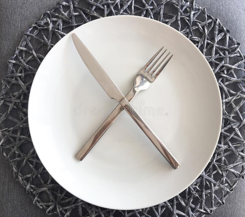 Modern White Plate and Silverware with Place mat stock photos