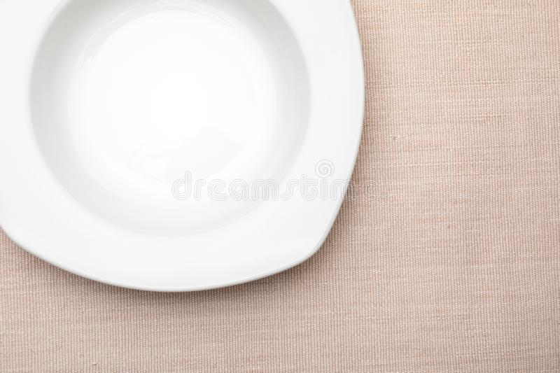 Empty white plate. On delicate beige tablecloth. Concept to include your food and your text stock photos