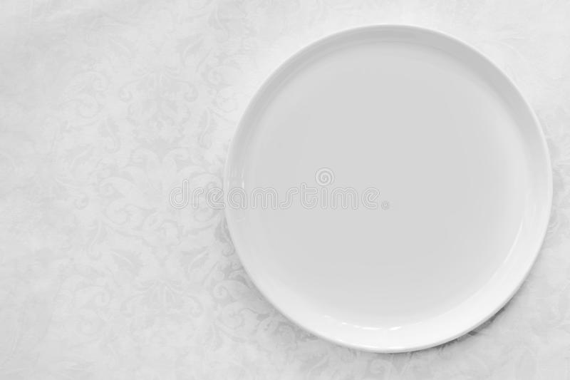 Download Empty White Plate Over Brocade Tablecloth Top View Stock Photo - Image of linen, object: 108555302