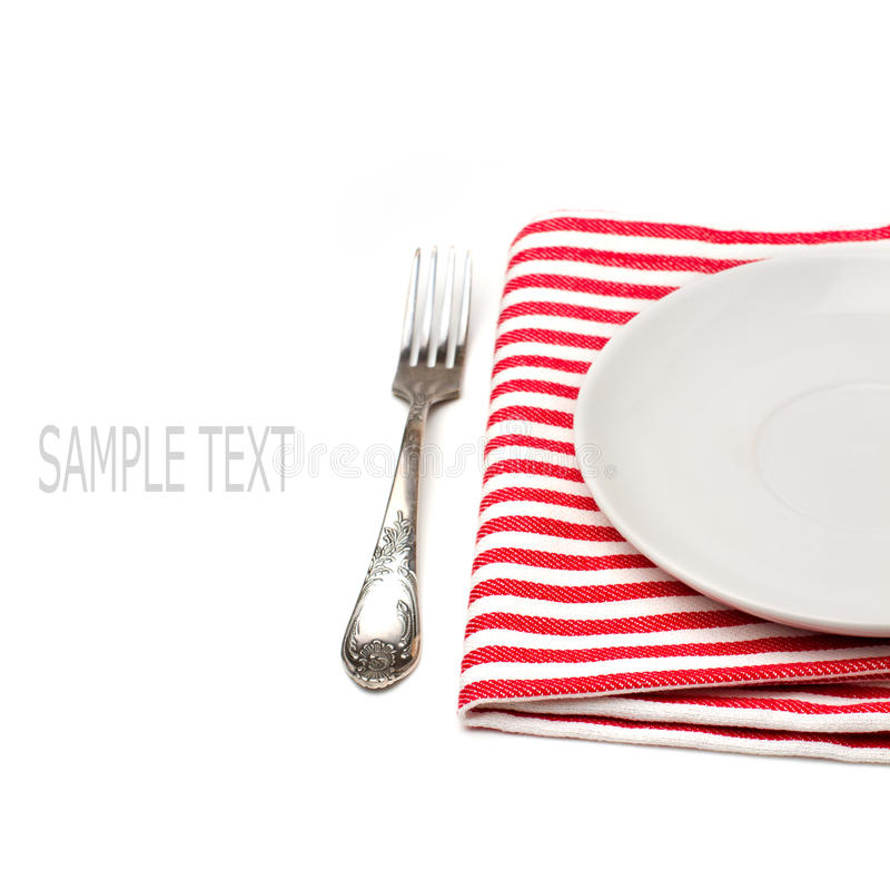 Download Empty White Plate On Tablecloth With Fork Royalty Free Stock Images - Image: 27853389