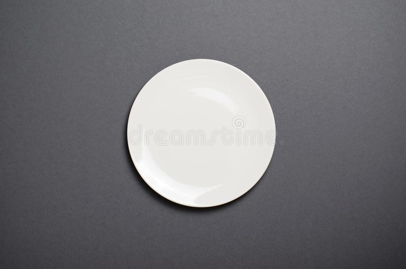 Empty White Plate, Top View on Grey Backround, Empty Space stock photos