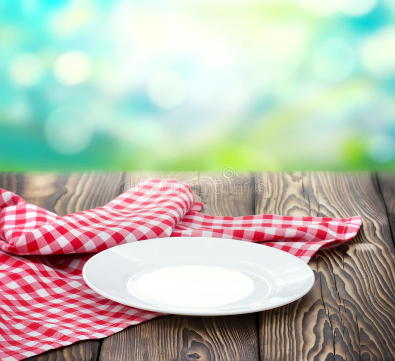 Empty White Plate On Wood Nature Blur Background Stock