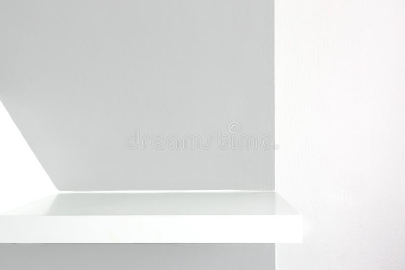 Empty white shelf, retail shelves from plywood frame. royalty free stock image