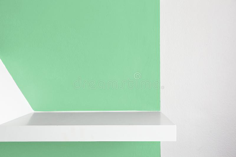 Empty white shelf, retail shelves from plywood frame. green colo stock photography