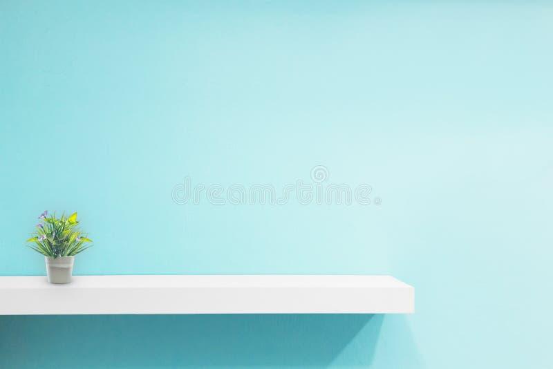 Empty white shop shelf, retail shelf on blue vintage background stock image