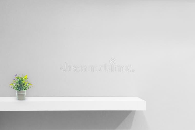 Empty white shop shelf, retail shelf on grey vintage background stock photography
