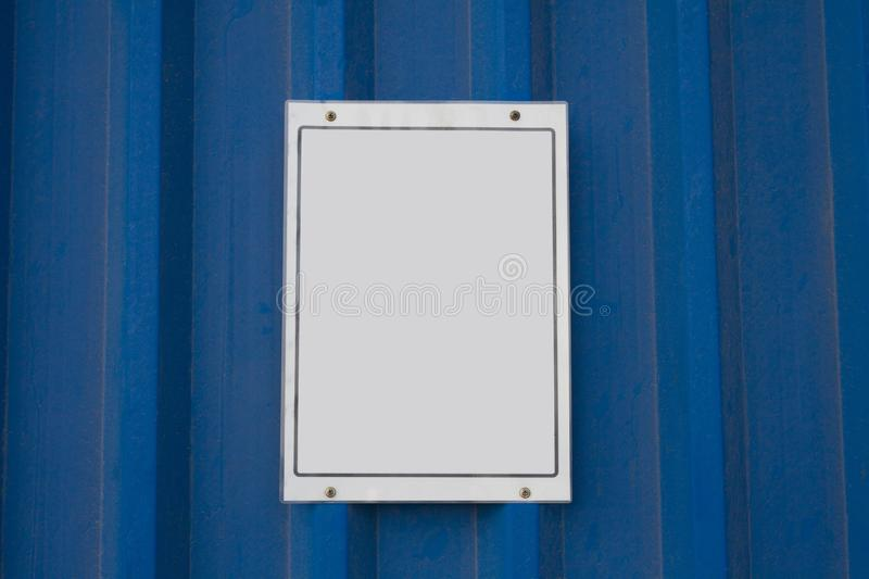 Empty white sign on metal board stock photography