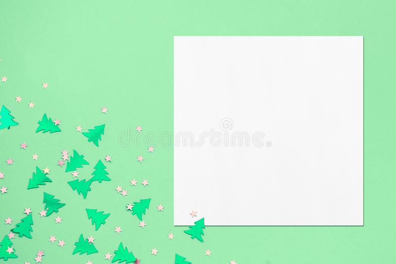 White square flyer or business card mockup on christmas mint background. Empty white square flyer or business card mockup with soft shadows on mint background royalty free stock images