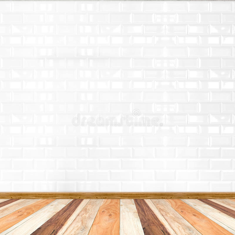 Empty white tile wall and wooden flooring,mock up for display of. Product royalty free stock image