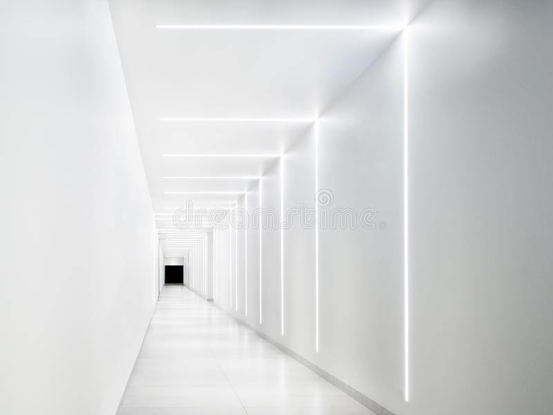 Empty white tunnel with a dark exit at the end stock images