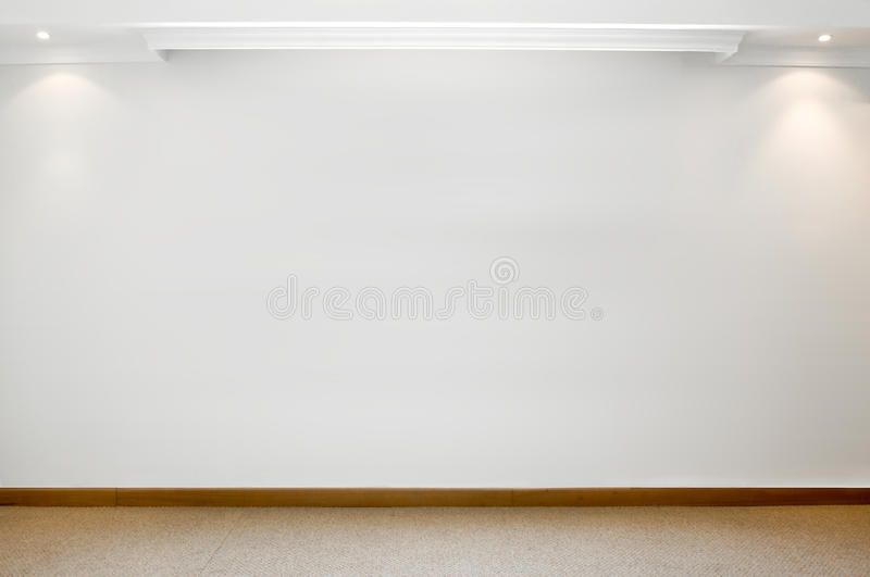 Empty white wall with carpeted floor stock images