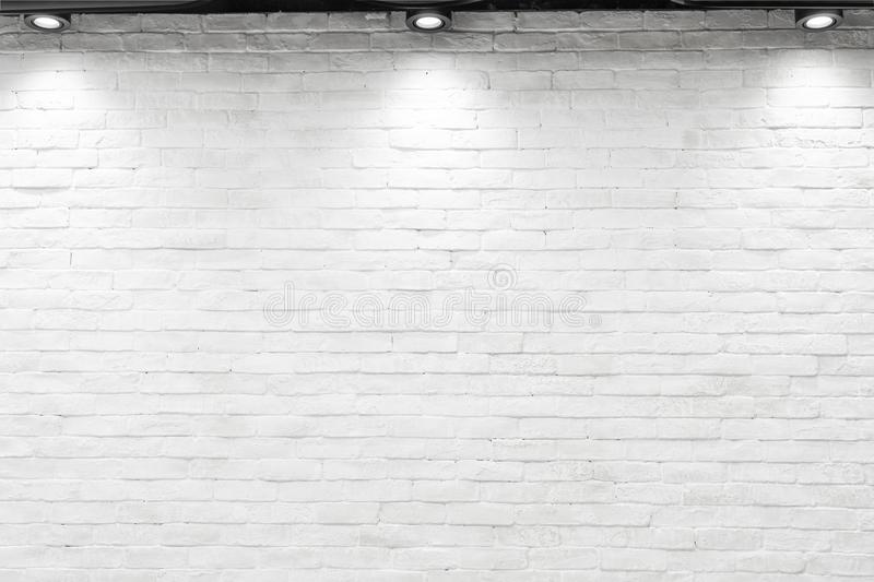 Empty white wall with halogen with lamps. stock photos