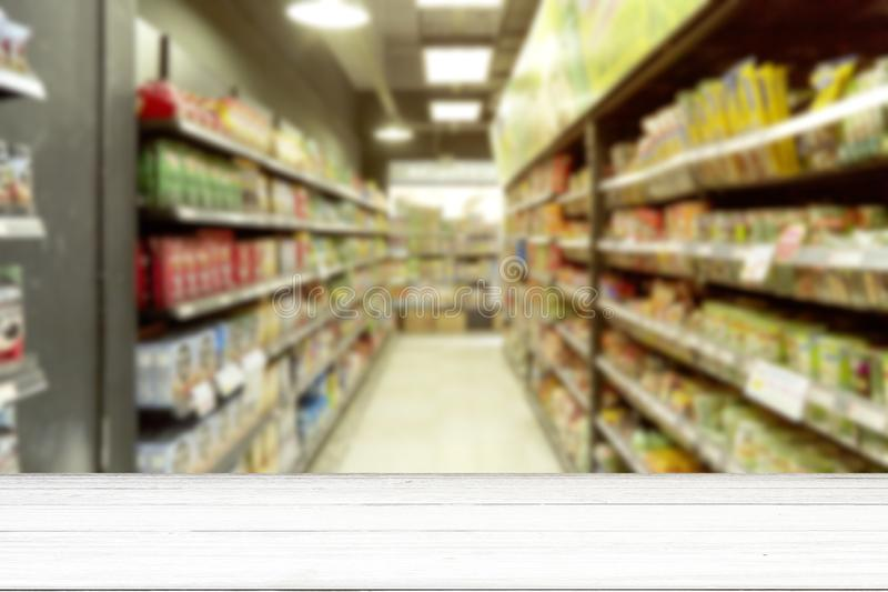 Empty white wood table supermarket blurry for background stock photo