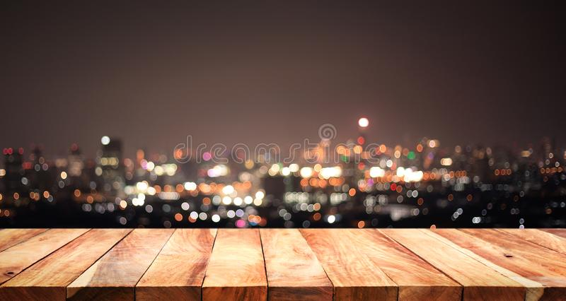 Empty of white wood table top on blur night town,cityscape royalty free stock photography