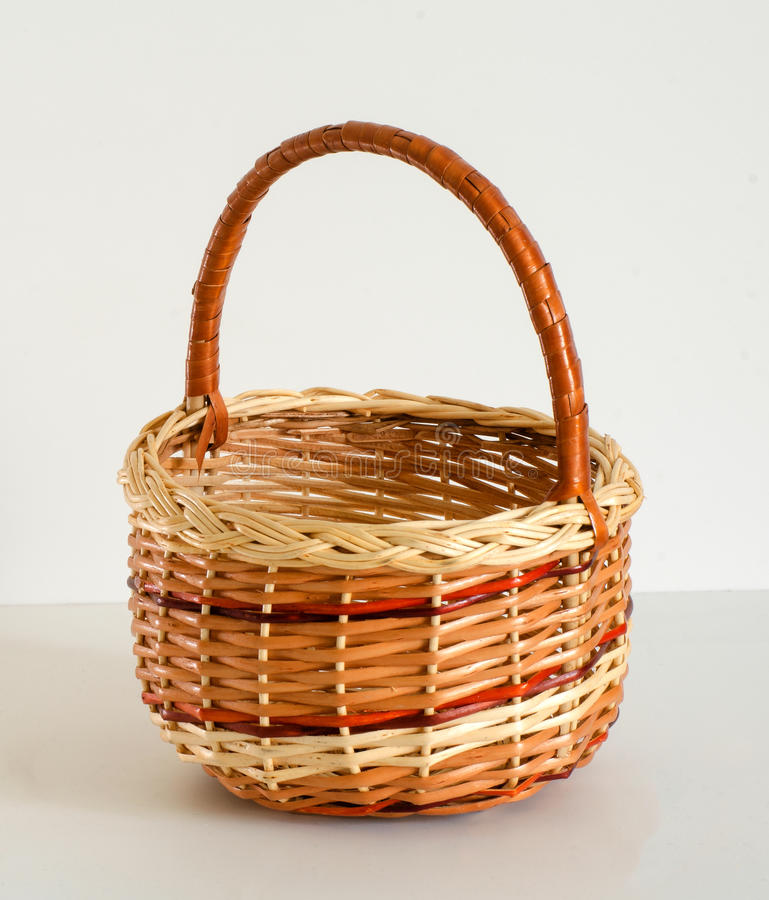 Empty wicker basket on white background stock image