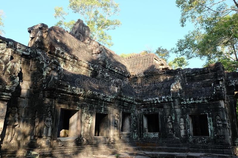 Empty windows of a dilapidated temple. Medieval ruins in Indochina.  royalty free stock photography