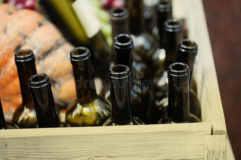 Empty wine bottles in wooden box. Shallow depth of field. Soft focus photography. horizontal. toned. Image royalty free stock photos