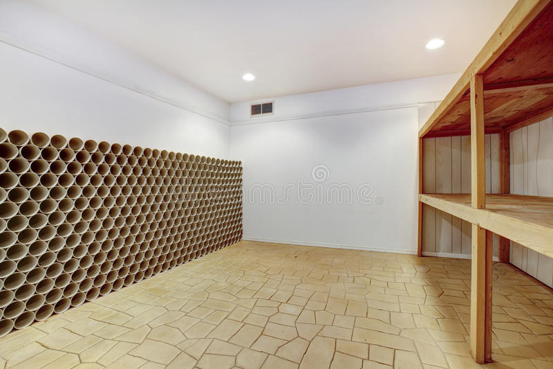 Empty wine cellar. With wooden shelves and wine storage unit stock images