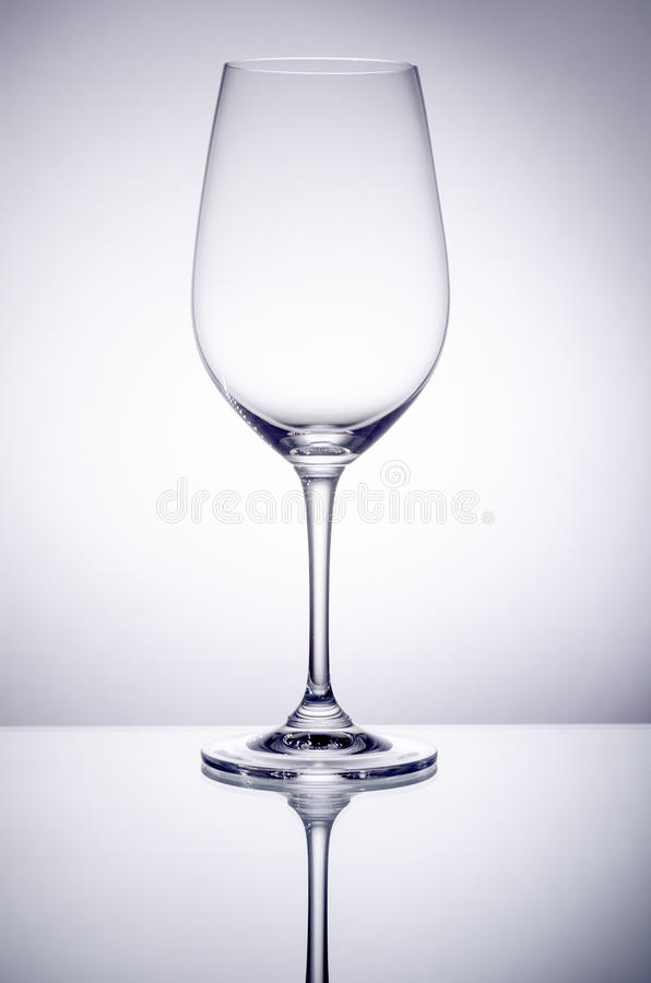 Empty Wine Glass Back Lit royalty free stock image