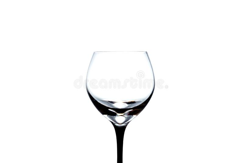 Empty wineglass close-up isolated on a white stock photography